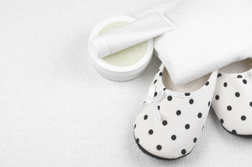 Feminine slippers and toiletry