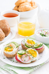 buns with egg and vegetables for breakfast, vertical