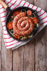 Grilled sausage in a pan. Vertical top view