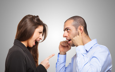 Man covering his ears in front of a woman