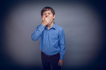 teenager boy of 10 years  European appearance sleepy, yawning,