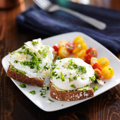breakfast with toast and poached eggs on top of avocado