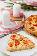 tomatoe pizza slice on white plate