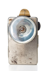 Old grunge flashlight on white background