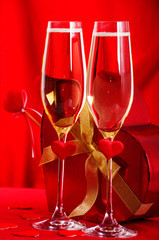 Glasses of Champagne and gift