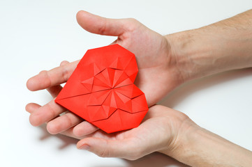 Heart in hands, origami