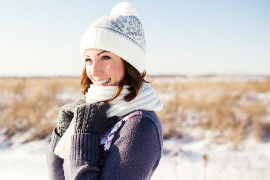 Portrait of happy young woman have fun at beautiful sunny winter