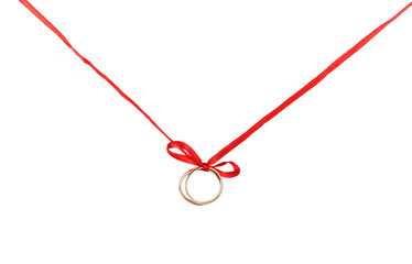 Golden rings on a red ribbon