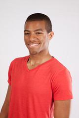 Black man smiling at the camera