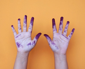 Close up of child hands painted with watercolors