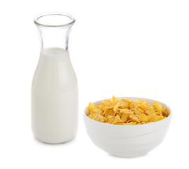 cornflakes and milk isolated on white