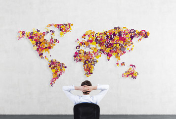 businessman looking to world map