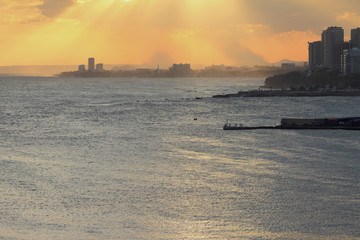 Seaside city at sunset. Santo Domingo, Dominican Republic