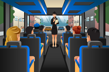 Tour guide talking to tourists in a tour bus