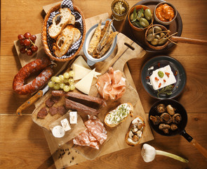 Homemade Tasty Tapas on Wooden Table