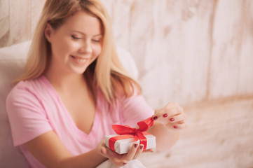 Blonde beauty with gift for Valentines Day