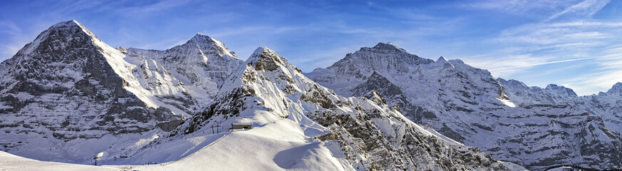 Foto auf Acrylglas Alpen Four alpine peaks and skiing resort in swiss alps