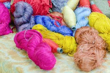 colorful silk yarns being dried