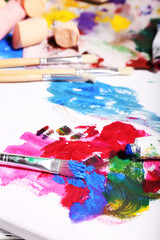 Professional art materials on color wooden background