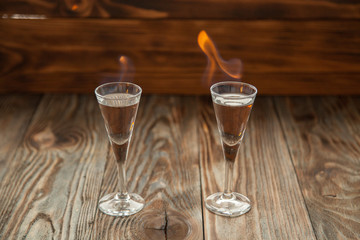 Shot glasses with alcohol on fire
