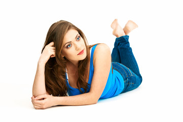 Casual style dressed young woman lying on white