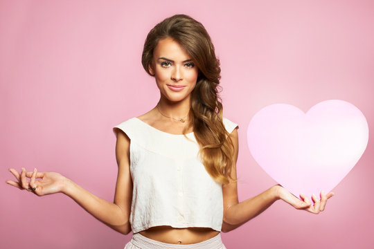 Love and valentines day woman holding heart smiling cute
