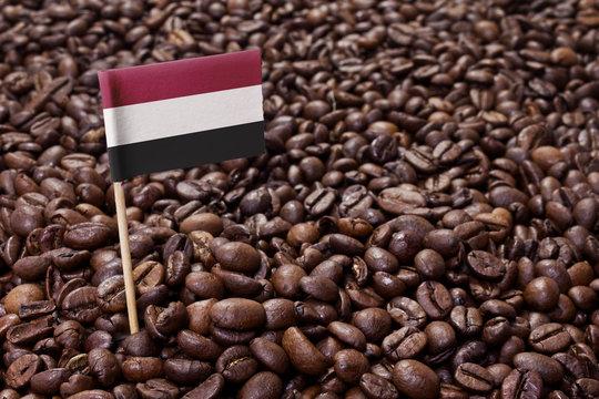 Flag of Yemen sticking in coffee beans.(series)