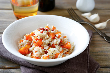 rice with fried carrots in a white bowl