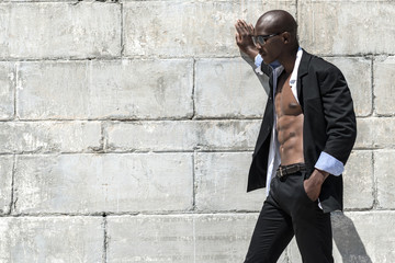 African black man model with six pack in black suit