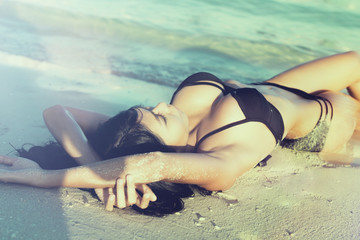 Sexy woman in beach vacation lying on sand