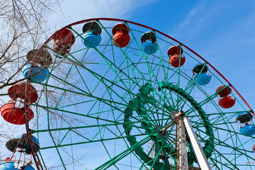 Colored ferris wheel over blue sky background