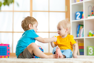kids play together with educational toys