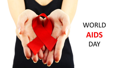 Woman in black holding red  AIDS ribbon isolated on white