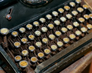 retro black rusty typewriter with white keys