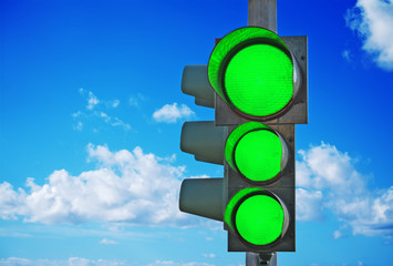 traffic light with three green lights on