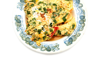 Vegetable omelet with eggs on a plate. Photo.