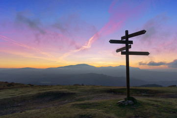 wooden signpost on mountain