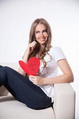 Happy woman writing a love card