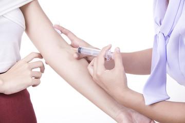 Nurse injecting a patient