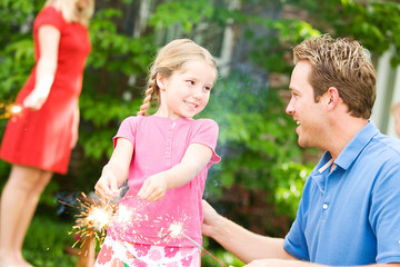 Summer: Dad Teaches Girl To Use Sparklers