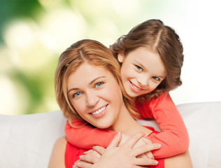 happy mother with daughter hugging and talking