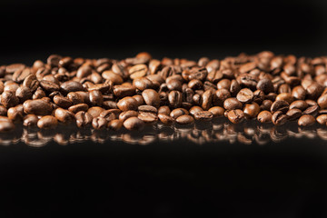 Line of Aromatic Roasted Coffee Beans Placed over Black