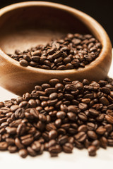 Closeup Image of Woden Bowl With Roasted Coffee Beans Over Blac