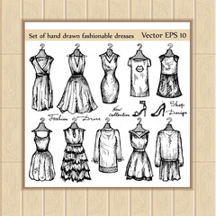 Vector set of hand drawn fashionable dresses for use in design