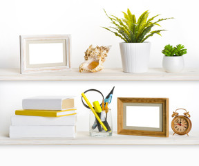 Wooden shelves with different office related objects