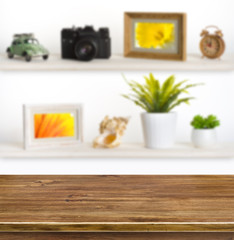 Wooden table on background of shelves with travel objects