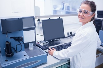Portrait of a smiling young scientist with safety glasses