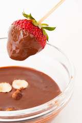 beautiful delicious strawberry with chocolate and nuts on stick