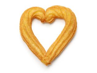 homemade heart shape churro isolated on white background