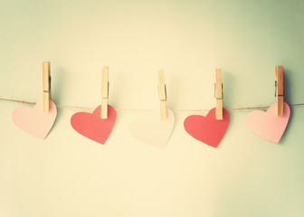 Vintage cotton hearts hanging from clothespins